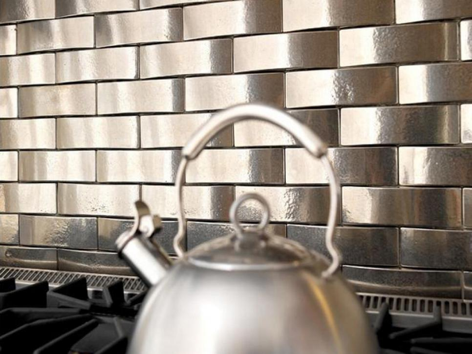 From HGTV.com metal kitchen backsplash idea
